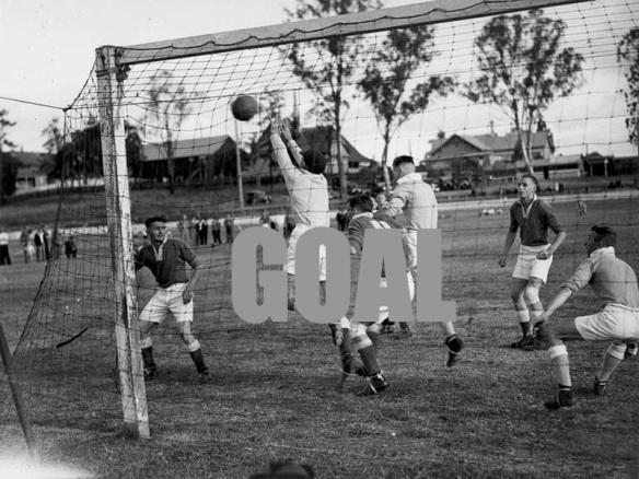 800px-StateLibQld_1_194039_Shot_for_goal_during_a_soccer_match_in_Brisbane,_ca._1937